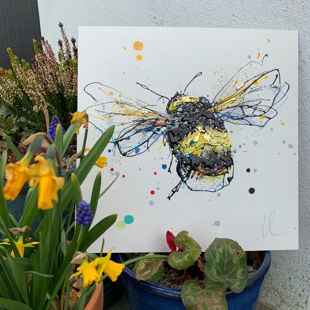 Photo of Buzzy the original bee painting in the garden